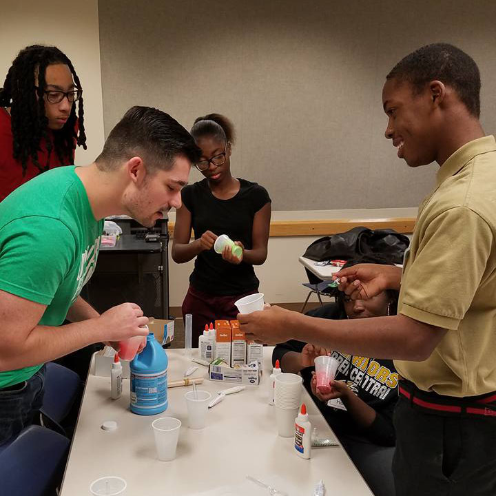 Upward Bound students at ATS Chemistry class doing an activity with slime.